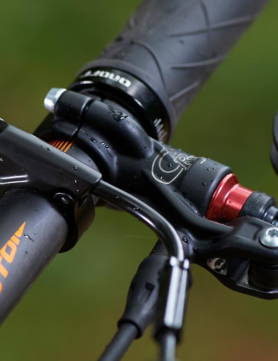 The Kashima coated Fox shocks are controlled by a bar mount lever