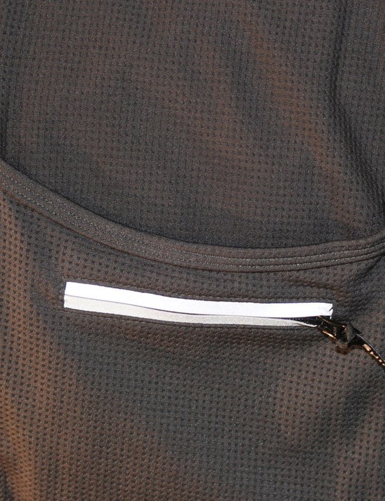 The jersey has reflective elements visible from all sides of the rider