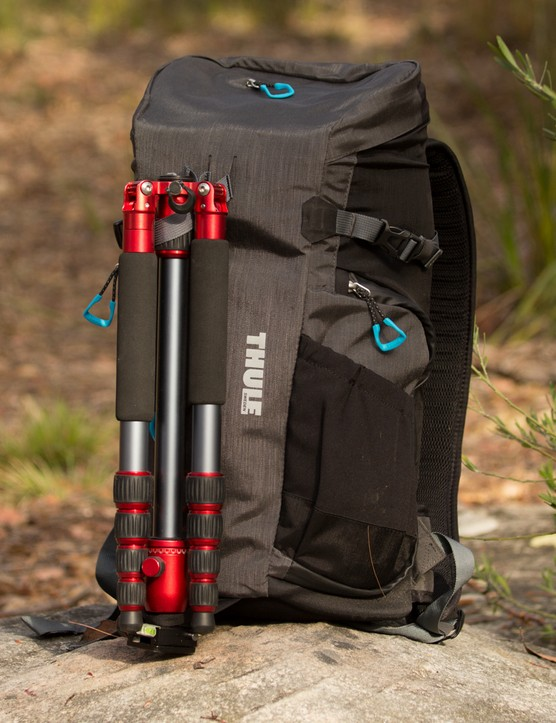The Thule Perspektiv Daypack can hold a small tripod on the outside. The tripod strap is also removable