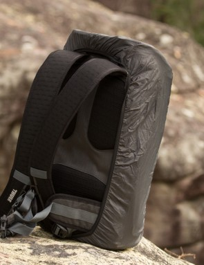 The rain cover wraps around the pack – assuming you keep it on your back, your gear will stay dry