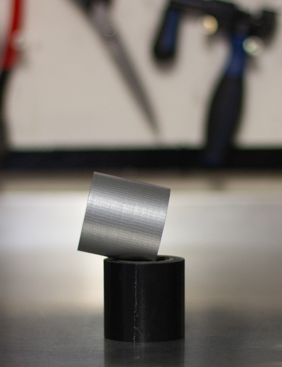 Tearable duct tape is handy to keep around. It's strong enough to patch a tyre and works well for saddle tears too