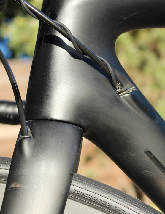 Hydraulic and electric lines are tucked into the frame and fork
