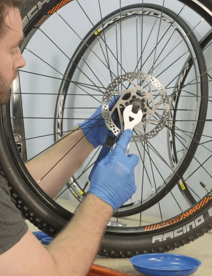 Replace the bearings into the bearing race, then return the axle and tighten the comes using the cone spanners. Finally, reinstall the cassette (and skewer if you have one) and return the wheel to the bike