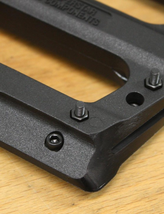 The El Plastique plastic pedals have six adjustable and replaceable steel pins on each side