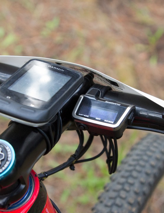 The Garmin is obvious, but the screen to the right of it is the new Shimano XTR Di2 Synchro unit, displaying gear selection, battery life and suspension settings and doubling as the system brains