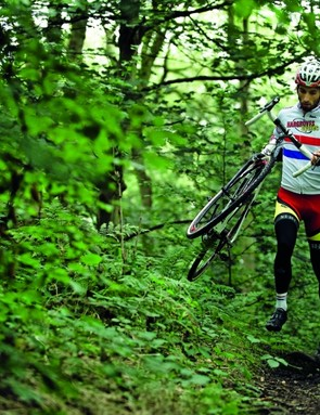 Carrying the bike by the bar and top tube is the best way to quickly get across obstacles on foot