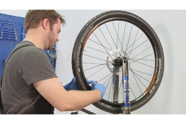 Engage the nipple with the thread of the new spoke and bring the nipple up to tension using a spoke key. Remember that the nipple tightens anti-clockwise as you look at the inside of the rim