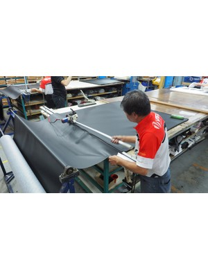 Saddle cover materials are first cut into more manageable sheets