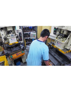 This saddle rail production station uses three separate hydraulic presses to turn a straight rod into the final shape