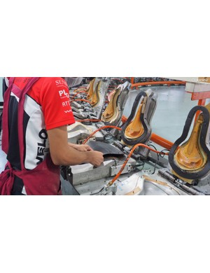 The inner surface of the saddle covers are also marked to provide visual cues to workers - where to apply glue, how to position it in the mould, and so on