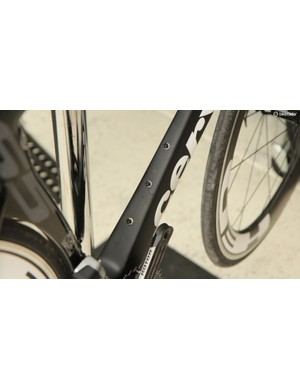 If you really want to maximize aero gains, you can run a single bottle cage low on the down tube. If you want to use the traditional two cages, then you need to use the two higher bolts