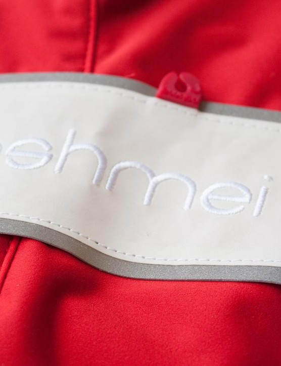 A branded reflective strip runs right down the back of Ashmei's softshell jacket
