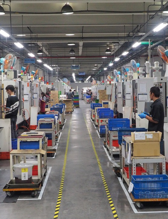 The building is chock-full of CNC machines and lathes. We lost count of how many were on the factory floor - and keep in mind that this is but one row, in one section of the building