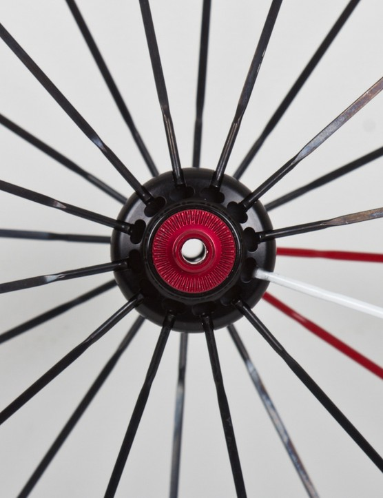 The front wheel is laced radially with 24 spokes