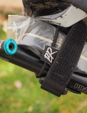 Hate traditional saddle bags? Give Backcountry Research's new Camrat straps a try. Repair items are first loaded up in the dual shock cords, and then the whole bundle is secured attached beneath your seat