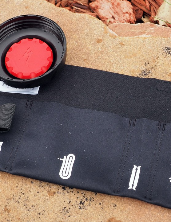 Inside the deluxe version of the Keg is a neoprene tool organizer (it wraps around an inner tube). Meanwhile, a compartment inside the cap holds glueless patches