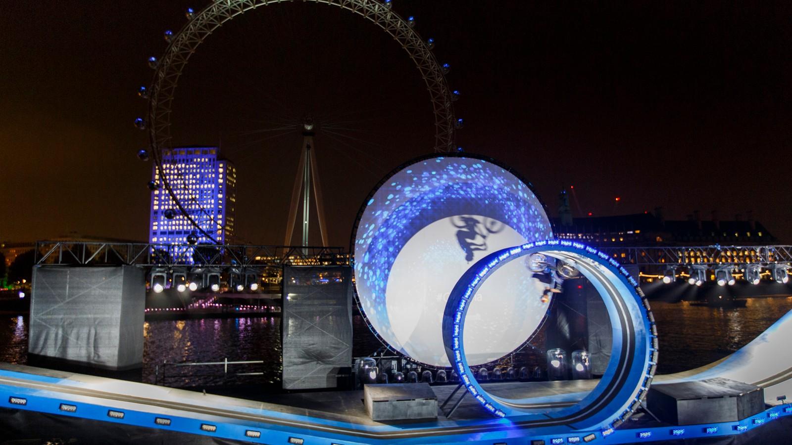 Danny MacAskill performs loop the loop in front of the London Eye