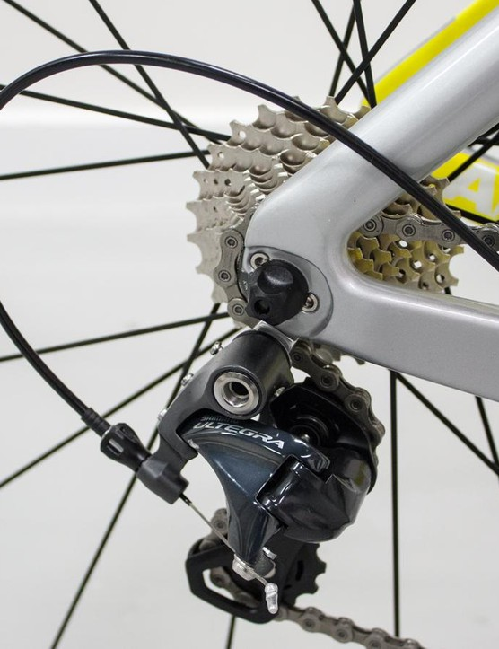 The rear gear cable runs under the BB inside the frame an out on the chainstay