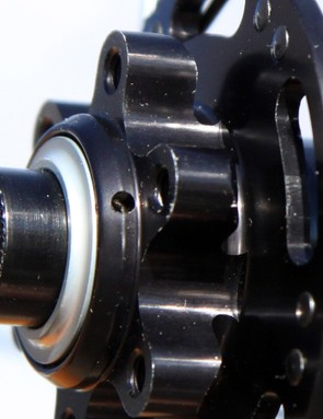 Bearing preload is rather crude, with a freely sliding collar that secures to the axle via three set screws