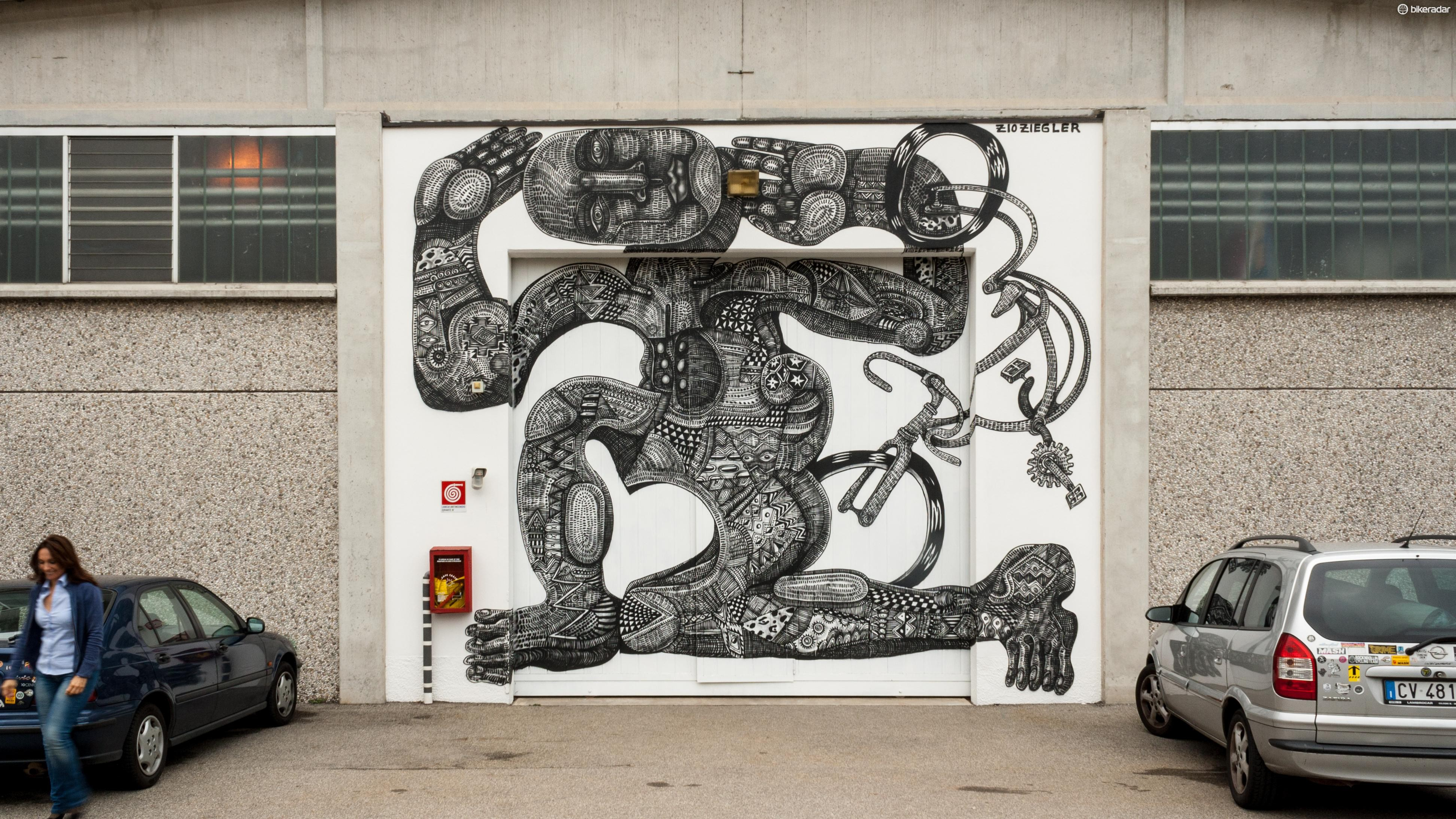 Street artist Z10 Ziegler has painted this figure on the entrance to the Columbus factory