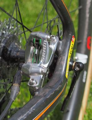 See that bit of green on the brake pad backing plates? Helen Wyman runs SwissStop pads, not standard SRAM ones