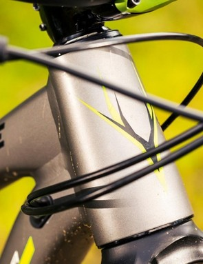 A stocky head tube houses the rough and tumble ready 130mm Pike fork