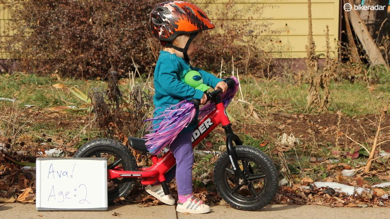 A balance bike like this Strider is a great introduction to riding bikes. By teaching balance and bike control separate from pedaling and braking, a balance bike can allow a child to skip training wheels when they move to a pedal bike