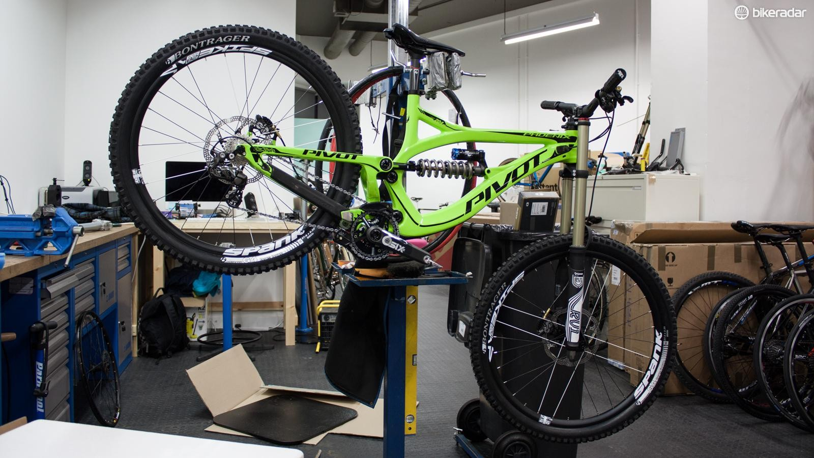 The Pivot's luminous green paint job makes it stand out as you flash down trails