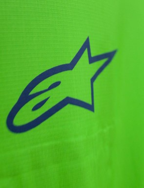 The Alpinestars logo sits on the jacket's chest
