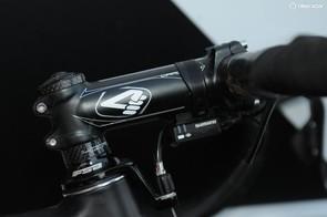 Pauwels runs a standard 120mm 4ZA Cirrus Pro aluminum stem and steerer tube mounted front brake cable hanger