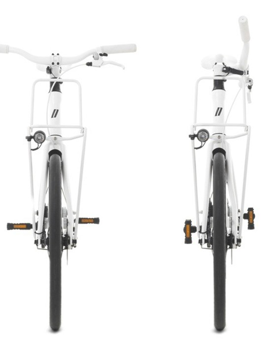 The handlebars twist to the side with the pedals flipping up for easy storage