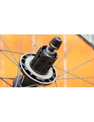 The freehub body is aggressively machined to trim weight. A knurled steel driveside axle cap on the rear hub should prevent pull-outs under extreme power