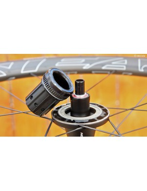 The 52-tooth ratchet ring yields a very quick 6.9-degree engagement speed. Meanwhile, the axle is supported by bearings that are spaced unusually far apart (which bodes well for bearing life) and the freehub body is supported by an enormous angular contact bearing on the inboard side