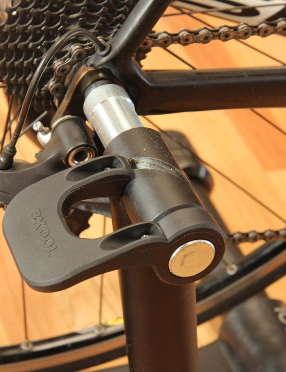 The Bkool Pro Trainer clamps easily and securely onto the rear QR