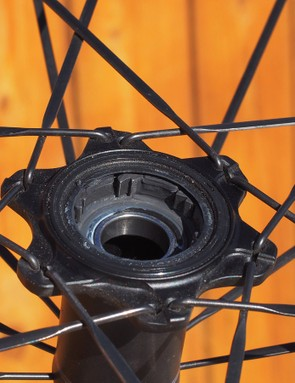 The rear hub features a reversed pawl layout. Note how the driveside spoke flange is positioned directly around the pawl pivots to reinforce that area from cracking under load
