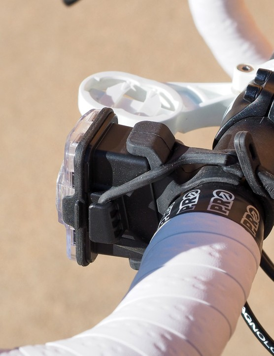 As the front light uses the same case as the rear, however, it requires an additional bulky rubber block to put it in the correct orientation. The lack of a shroud means the rider's eyes aren't protected from the flashing, either, which negatively impacts night vision