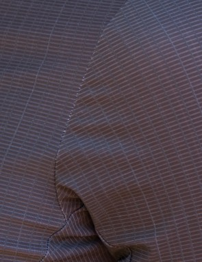 The carbon-reinforced fabric has a visible block weave which should aid in wicking