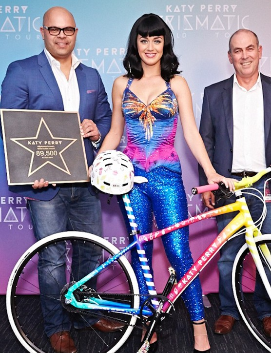 Katy Perry looks pretty stoked with her new set of wheels