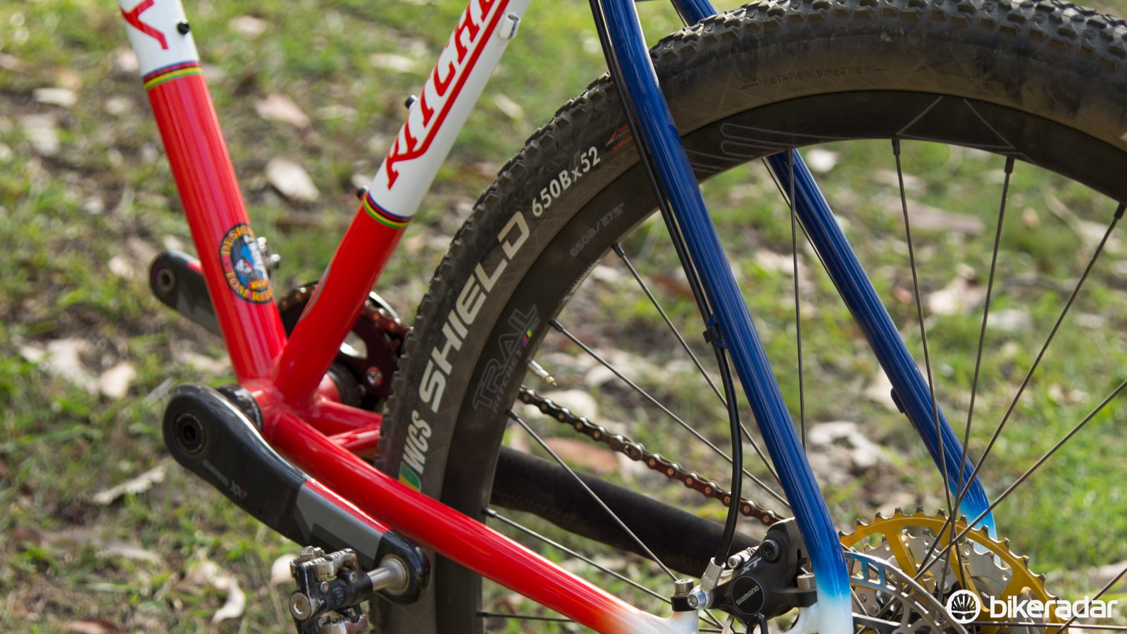 The rear brake is cleanly tucked within the rear triangle. Cheaper brakes without banjo-type hose connections will likely suffer from awkward bends to reach the seatstay hose routing