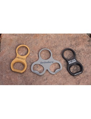 Wisecracker - an offshoot of handmade frame builder Mike Ahrens - offers bike-mounted bottle openers in several materials, styles and attachment methods