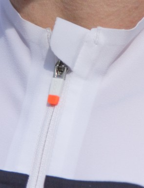 The material is soft and doesn't rub or chafe. A small guard is added at the top and bottom of the zipper