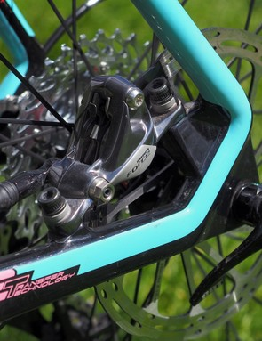 The rear brake caliper is tucked safely away inside the rear triangle