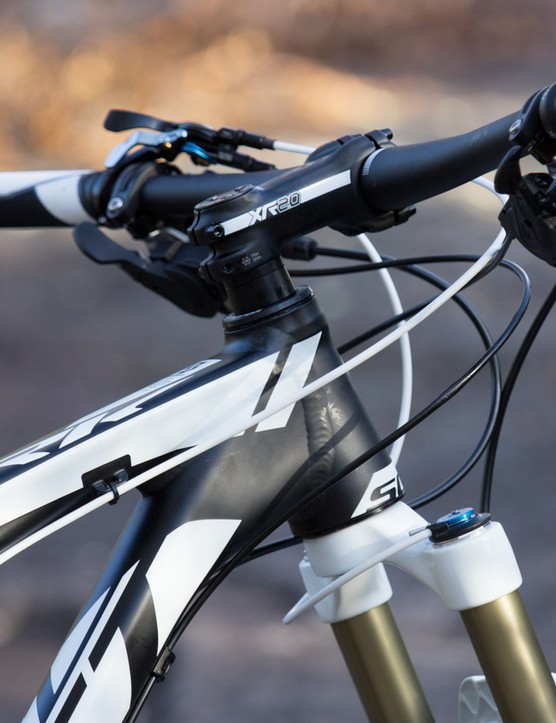 Showing its race colours: a stout tapered head tube and low-riser handlebar allows for an aggresive and low position if you desire