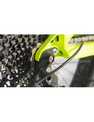 The rear derailleur is bolted to a burly replaceable hanger