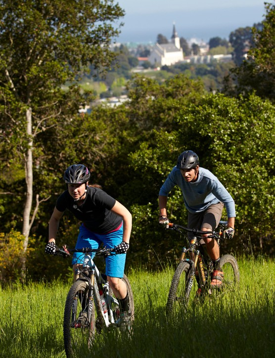 Zaffke keeps on the tail of his wife, Katie, as they ride the hills around Santa Cruz