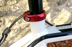 The red anodised seat clamp is one of the many classy touches on the bike