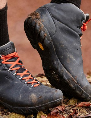 The full Vibram sole is grippy on flat wet surfaces (like pavement or stones), but doesn't have much bite in the mud