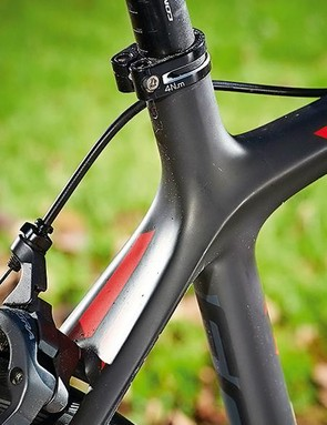 A hugely sloping top tube and plenty of exposed seatpost create a comfortable rear end