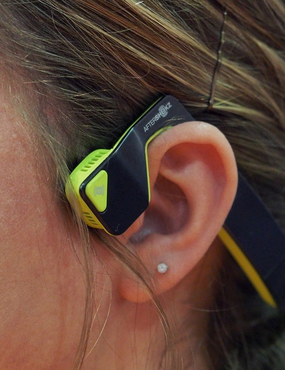 Bone conduction headphones such as the Aftershokz Bluez 2 send sound through your skull to your inner ear, leaving the ear canal open to hear ambient noise for better safety