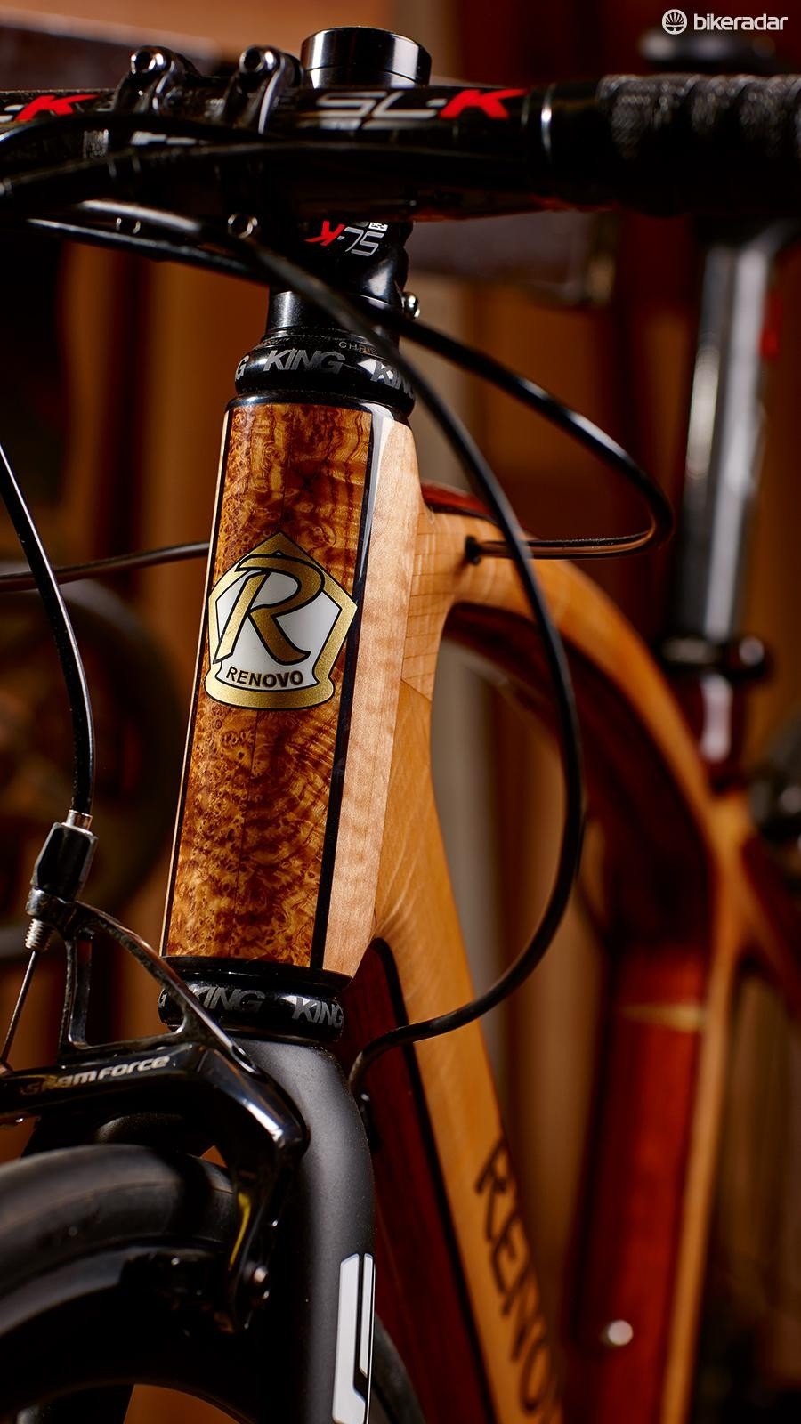 Visible grain on the head tube contrasts with functional-looking componentry